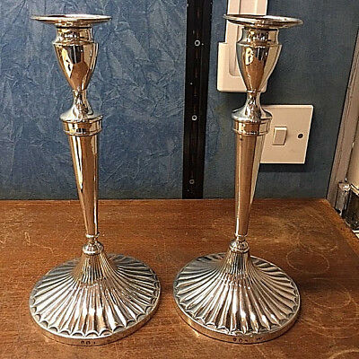 Pair of George III Irish sterling silver candlesticks