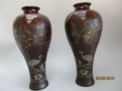 Two Japanese laquerware vases with hand painted crane designs.
