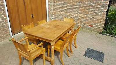 Solid oak 1950's table and 6 chairs. 4 normal chains and 2 carvers