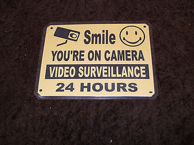 "Smile You Are On Camera Signs., Size 7 1/4""wide X 5 1/4"" Height"