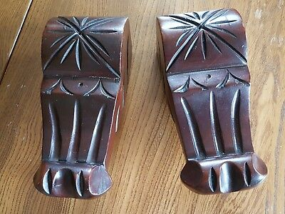 Pair of ornate carved wooden decorative corbels