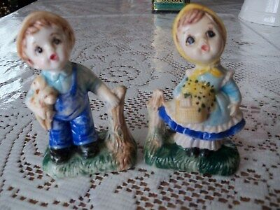 Vintage GIRL AND BOY Figurines marked Maggie on bottom PUPPIES FLOWER BASKET