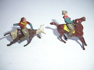 2 Vintage Metal Cowboys Riding Horse and Bull  from England Barclay?