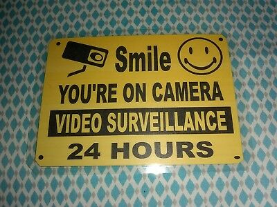 """SMILE YOU'RE ON CAMERA Warning Security Yellow Sign 7 1/4"""" wide x 5 1/4"""" height"""