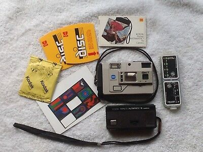 Vintage Minolta disc-7, Instamatic 18 cameras, flash, disc film, instruct book