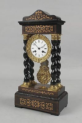 An original antique rosewood inlayed French portico clock