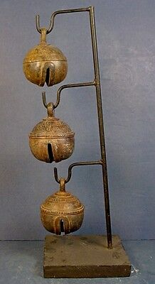 THREE ANTIQUE THAI BRONZE CROTAL ELEPHANT RUMBLE BELLS with METAL DISPLAY STAND
