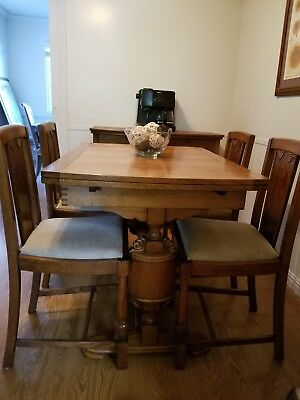 antique pocket/ draw leaf worm wood oak table with matching chairs.