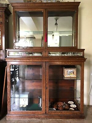 A late 19th century / circa 1900 oak glazed mirror backed display cabinet / case
