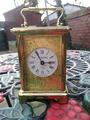 Brass Carriage Clock With Gold masked dial J.W Benson. Made in France.