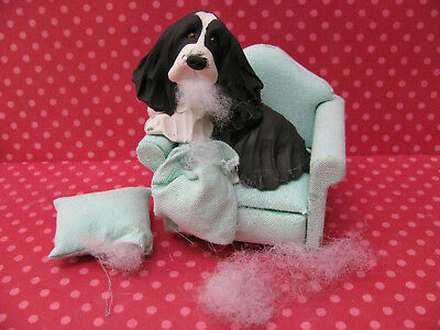 Handsculpted B/W English Springer Spaniel With Chewed up Sofa Pillows Figurine
