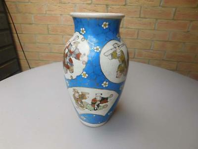 Large oriental Chinese ceramic blue and white vase with painted figures