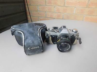 Canon AE-1 SLR 35mm film Camera with Canon lens FD 28mm 1:2.8, made in Japan