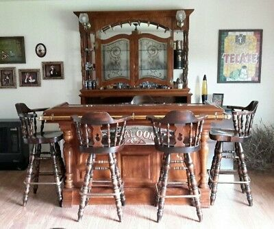 Antique Wood and Brass Saloon Bar. Glass and Gold etching and 6 stools.