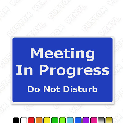 meeting in progress do not disturb no entry door notice hanging
