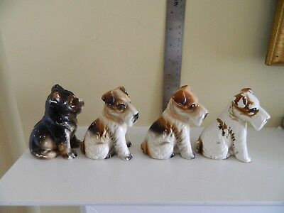 Four vintage Japanese ceramic/porcelain  dogs, two marked Japan, about 4 inches