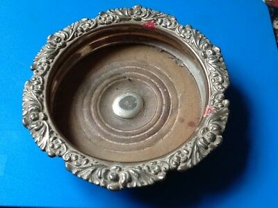A Victorian silver plated bottle coaster with turned wood base