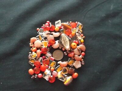 Job lot of mixed sized orange glass beads over 100 gms