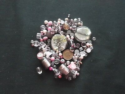 Job lot of mixed sized pink glass beads over 100 gms