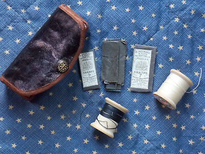 Small Shaker leather sewing kit or case with needles dated 1857.