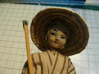 vintage doll: early  DOLL, Japanese worker on base, painted face, cloth