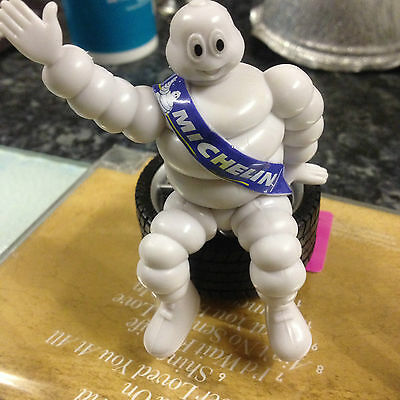 Michelin Man Seated On Tyre