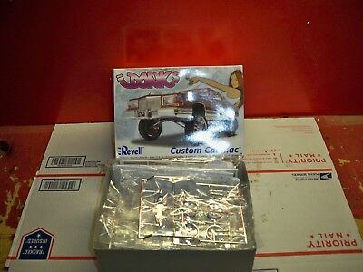 Revell Cadillac Donk Low Rider Open Box ,  Sealed Parts
