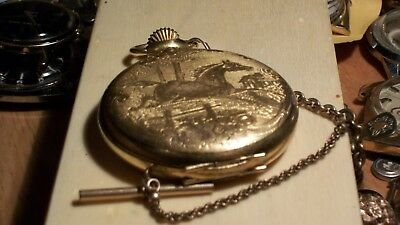 Antique Arnex swiss made pocket watch. Gold plated with horse. Decorated. Works.