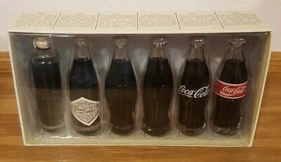 "COCA-COLA: ""EVOLUTION OF THE CONTOUR BOTTLE"" Set of 6 MINI BOTTLES 1899 to1986"