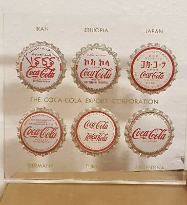 Coca Cola Export Corporation Global cap set in lucite block.  Crystal clear.
