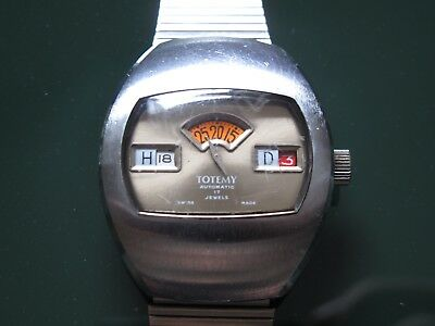 rare space age Automatic Scheibenuhr digital 70s Uhr designer Totemy swiss made
