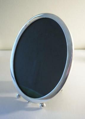 An Antique Silver Oval Photo Frame With Oak Back: Birmingham 1899