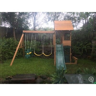 Wooden swing set slide and cubby house with look out and cafe seating