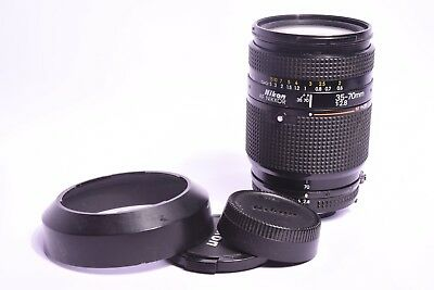Lens Nikon AF Nikkor f/2.8 - 35-70mm. #221600 with plugs and pare sun