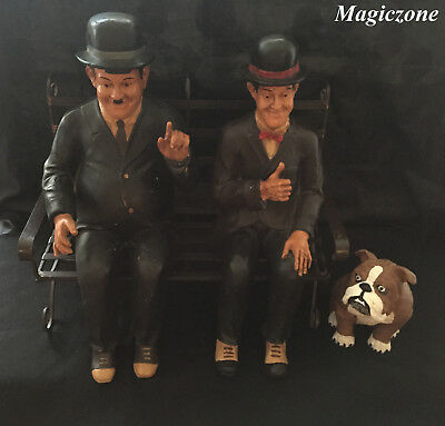 Laurel and Hardy Sitting On BenchWith Dog