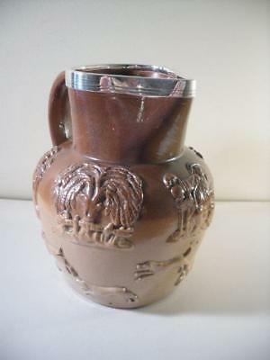 An Antique Stoneware Silver Rimmed Beer Jug : London 1874