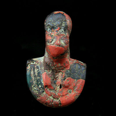 A Ptolemaic red and green glass amulet of Sekmet y853