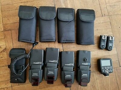 LOT of 4 YONGNUO Speedlite (YN-560-III and IV), battery pack and remotes
