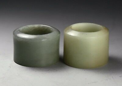Two Chinese celadon jade archers rings