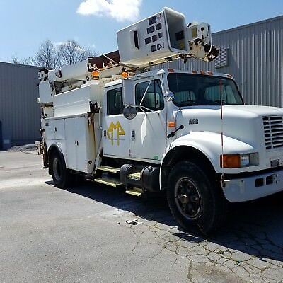 International bucket truck 4900 DT466e 4 door with a 28000 pound winch in bed