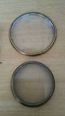 Clock bezels x 2 and a movement spares