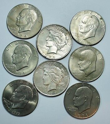 2 Peace Silver Dollars and 6 Ike Dollars