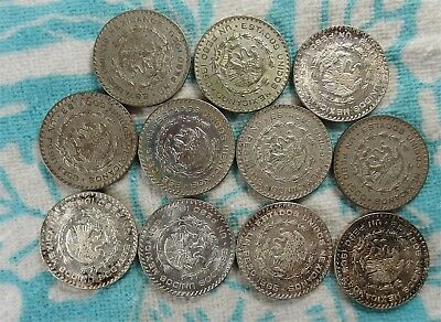 Lot of 11 - Mixed Date Mexico Un Peso 10% Fine Silver Coins with Edge Lettering