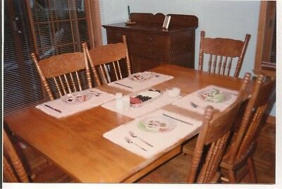 Queen Anne antique dining set. Table with 6 press backs and cushions.
