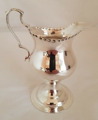 George V sterling silver cream jug .Birmingham 1912. By Deakin and Francis Ltd.
