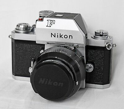 Nikon F SLR with 50mm lens, lens shade and cap, half case. Serial # 7360938