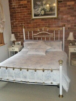 Antique queen brass bed