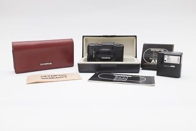 Olympus XA 35mm Rangefinder with original papers and soft and hard case A16flash