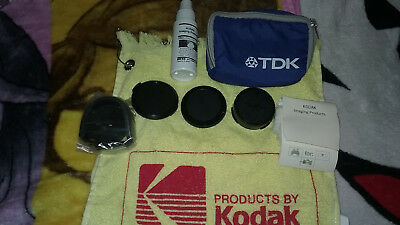 AE-1 Program Canon Camera Bundle comes with the lenses and cleaning spray .