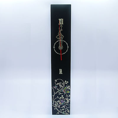 Black clock inlaid with mother of pearl tendril plants pattern wooden clock